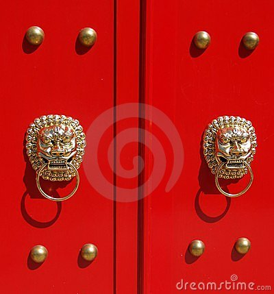 Golden Lions on Red Door