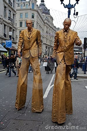 Golden Men on Stilts - London Shopping Day Editorial Stock Photo