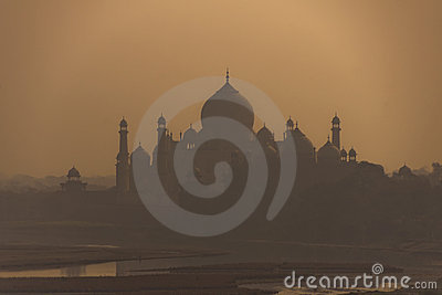 Golden morning glow of sunrise over the Taj Mahal