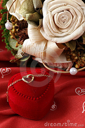 Golden necklace with heart