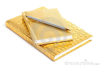 Golden notebook with pen