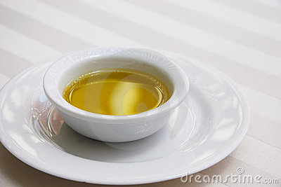 Golden Olive Oil on White Tablecloth