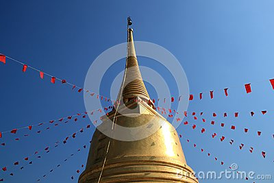 Golden pagoda with red flag of buddhism spell
