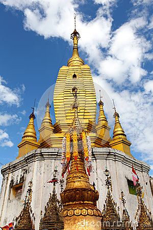 Golden pagoda on top of Mount Popa in Myanmar