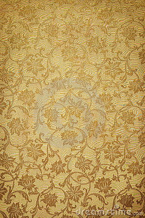 Golden pattern on wallpaper