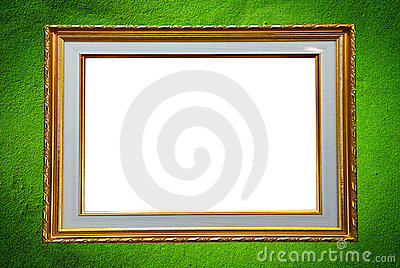 Golden photo frame on green wall