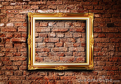 Golden picture frame on grunge brick wall