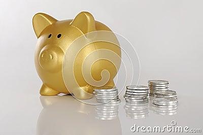 Golden Piggybank With Coins