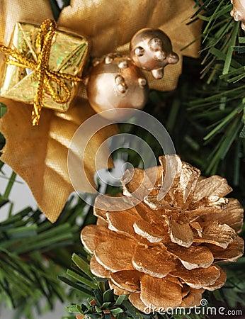 Golden pine cone on christmas tree
