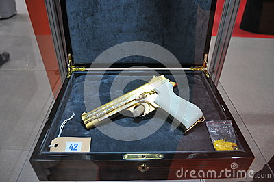 Golden Pistol Display in Abu Dhabi International Hunting and Equestrian Exhibition 2013 Editorial Photo