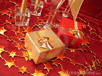 Golden and red gift boxes, stars on beautiful background with ch