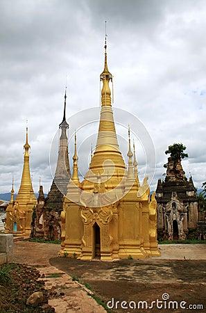Golden renovated temple ruins in Inthein, Myanmar