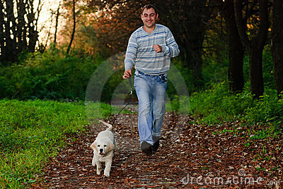 Golden retriever and man in park