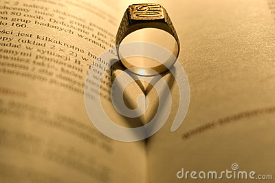 Golden ring in the open book