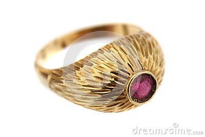 Golden ring with red gem