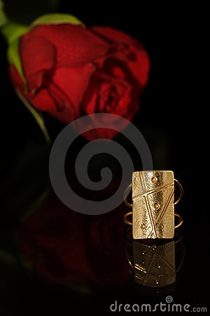 Golden ring and rose