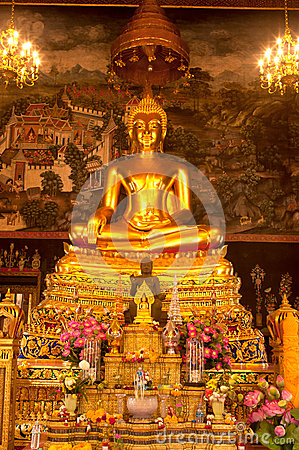 Golden sitting buddha in Thai church.