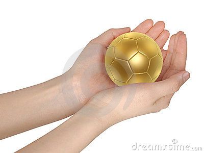 Golden soccer ball in hand