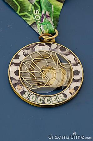 Golden soccer campaign medal