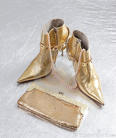 Golden spike heels and purse