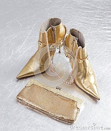 Golden spike heels and purse