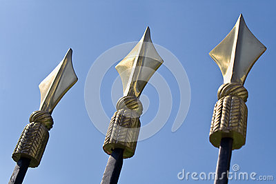 Golden spikes on iron fence