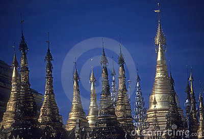 Golden spires of Buddhist stupas in temple