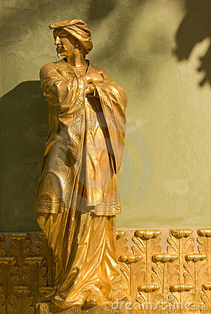 Golden statue of an oriental man