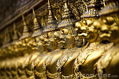 The golden statues at The Emerald Buddha Temple