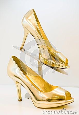 golden stiletto high heels royalty free stock images. Black Bedroom Furniture Sets. Home Design Ideas