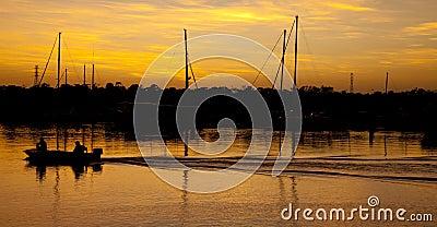 Golden Sunrise Fishing Boat Stock Photo