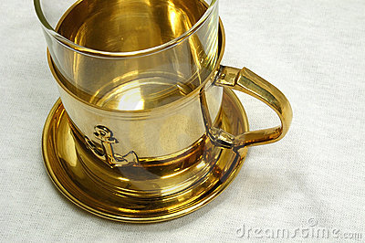 Golden tea cup Stock Photo