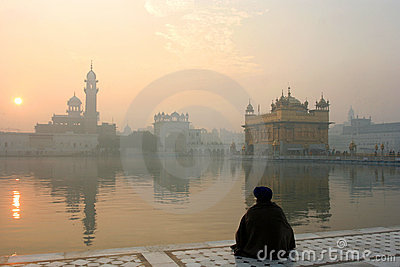 Golden temple with a man in meditation