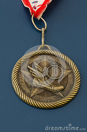 Golden track and field medal