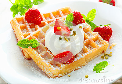 Golden waffle with strawberries and cream