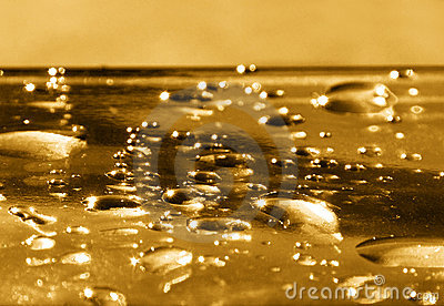 Golden water drops