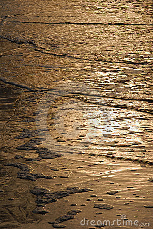 Golden waves texture on the beach