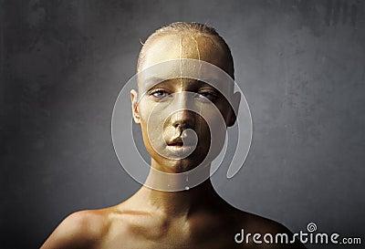 Golden wet visage