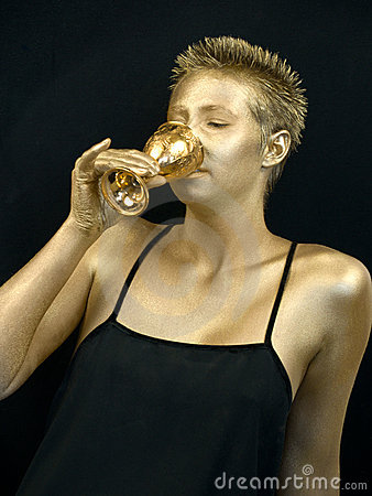 Golden woman drinking from a golden goblet