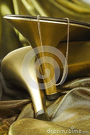 Golden womans shoes