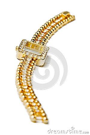 Golden wristwatch with gems
