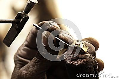Goldsmith making ring
