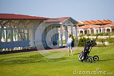 Golf bag. woman playing