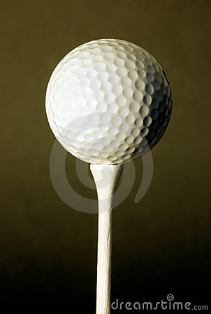 Golf ball against black background