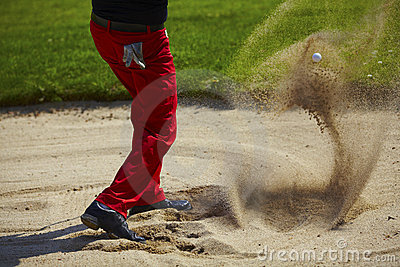 Golf ball in the air in the bunker