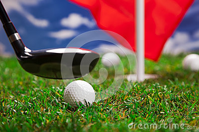 Golf ball and bat on grass!