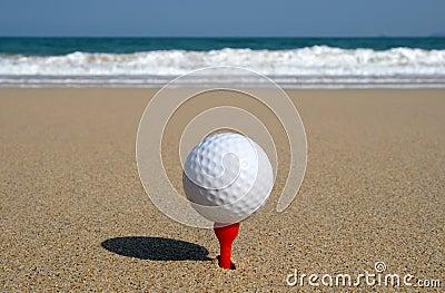 Golf ball on the beach.