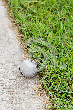 Golf ball on the cart path