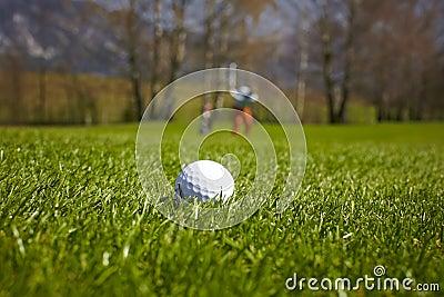 Golf ball close-up with golfer man