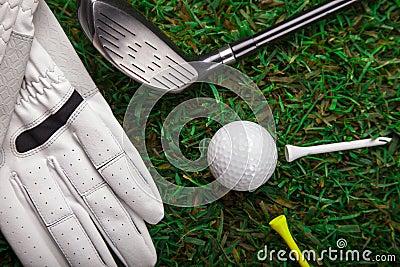Golf ball, glove and bat on grass!